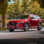 2020 new Mazda SUV driving in residential area