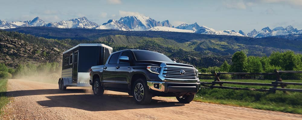2020 Toyota Tundra towing on dirt path