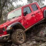 Red 2021 Jeep Gladiator with muddy tires