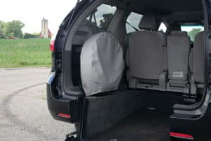 Half-cut Dodge Caravan with rear fold-down bench