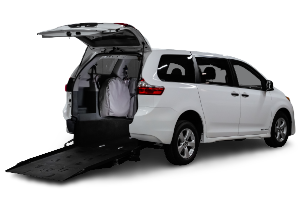 A white rear-entry Toyota Sienna from Freedom Motors