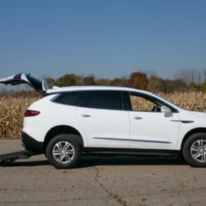 white wheelchair accessible Buick Enclave side profile with extended wheelchair ramp