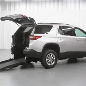 Rear entry white Traverse with wheelchair accessible ramp