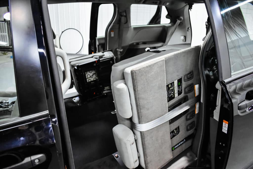 When folded down, 60/40 seats can be tucked in the sides of the vehicle. This allows up to two wheelchairs or one stretcher.