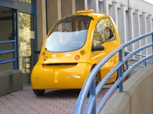 A Yellow Kenguru Electric Mobility Vehicle