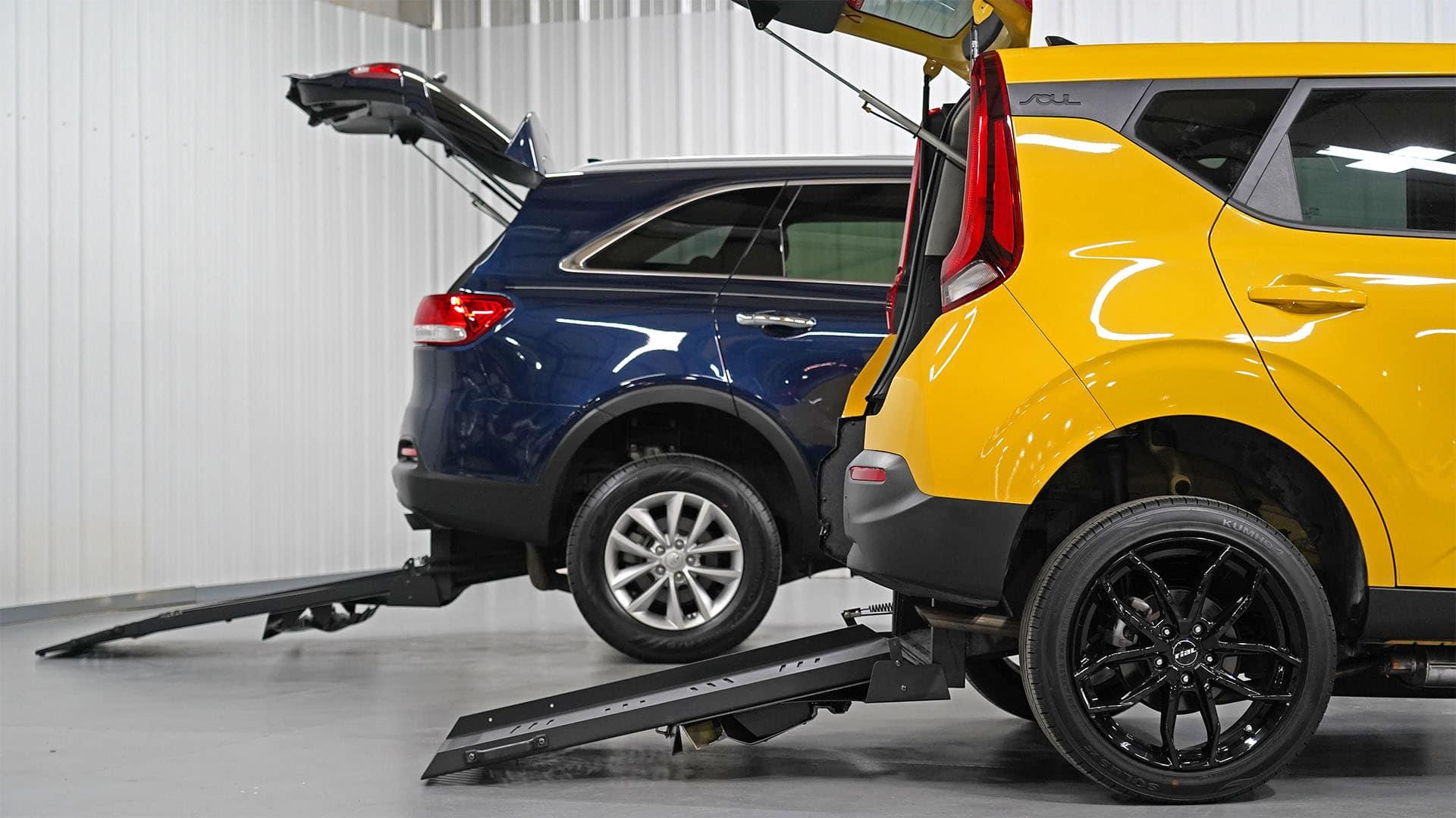 A Kia Soul and Kia Sorento with deployed wheelchair ramps