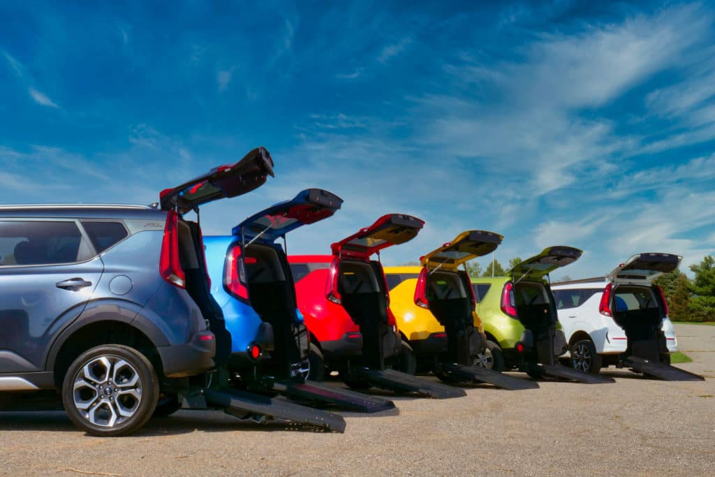 A rainbow-colored row of wheelchair accessible Kia Souls