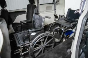 Two wheelchairs in a Freedom Motors USA wheelchair accessible Dodge Grand Caravan