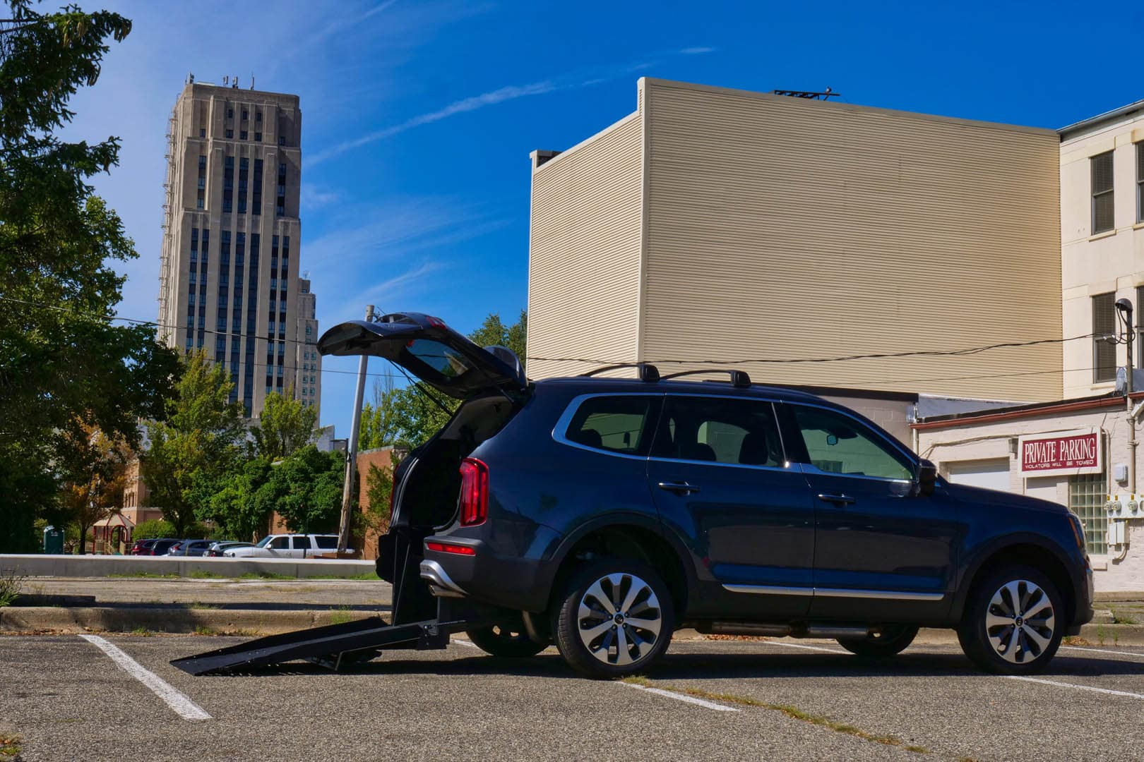 A Freedom Motors Kia Telluride wheelchair conversion outside with the ramp deployed.