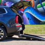 A Freedom Motors Kia Telluride wheelchair conversion with the ramp deployed.