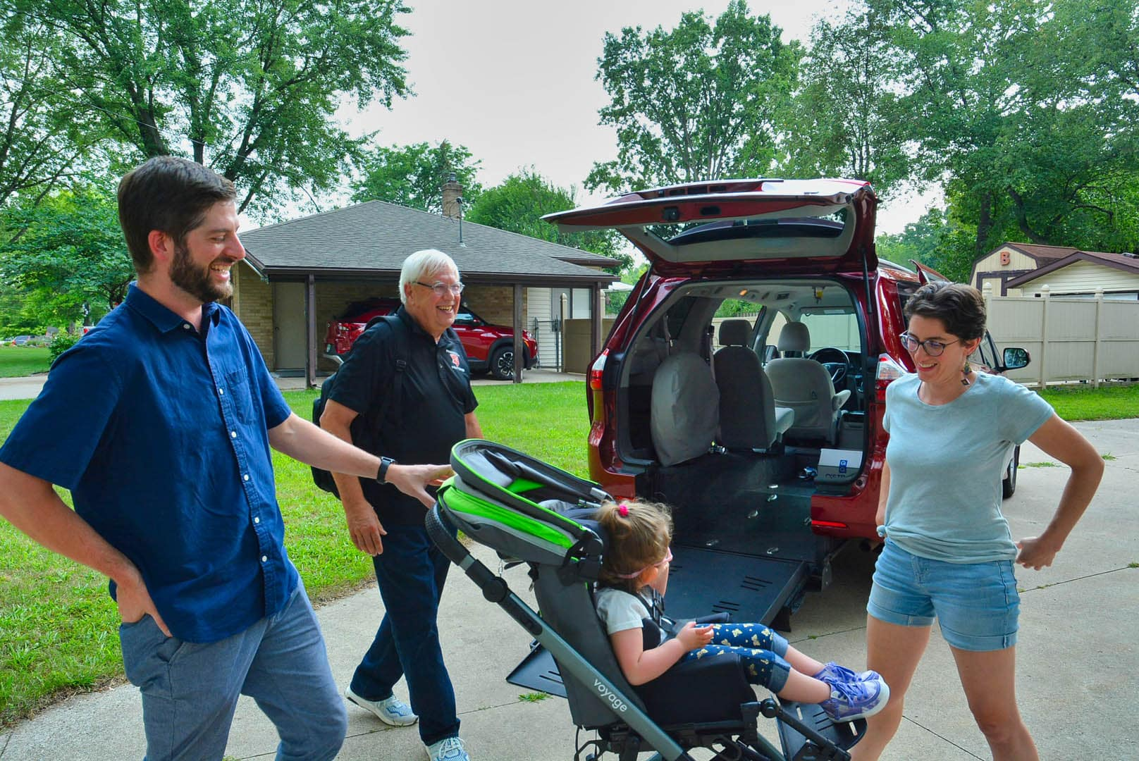 Rachael, Kyle and Ruby admire their new van from Freedom Motors USA.
