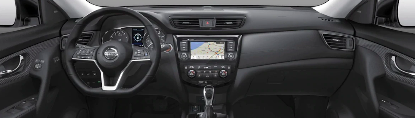 Front seat view of Nissan Rogue with Push Start button ignition