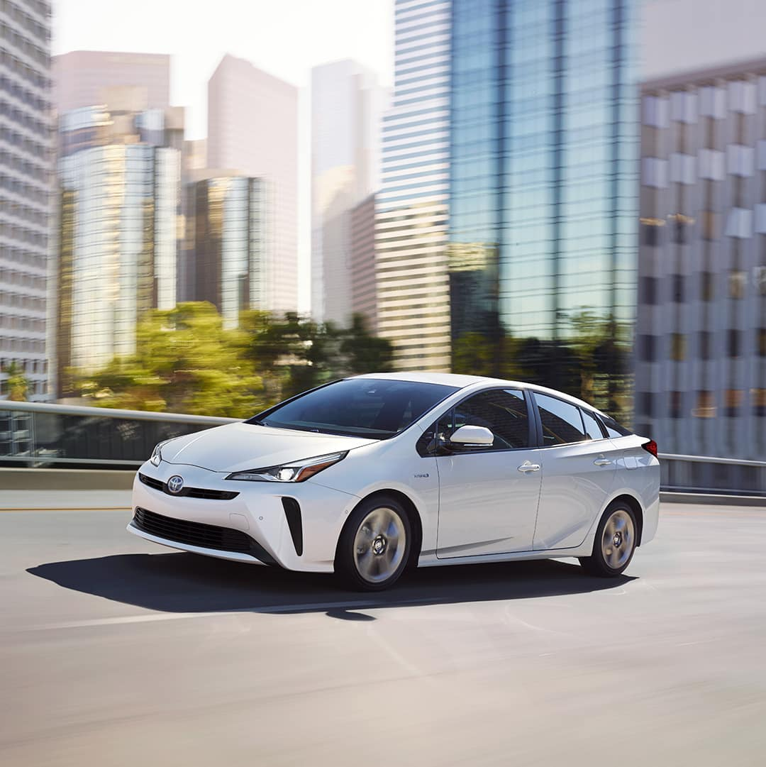 Hanover Toyota is a Toyota Dealership in Hanover near Harrisburg PA   White Prius Motion Highway City