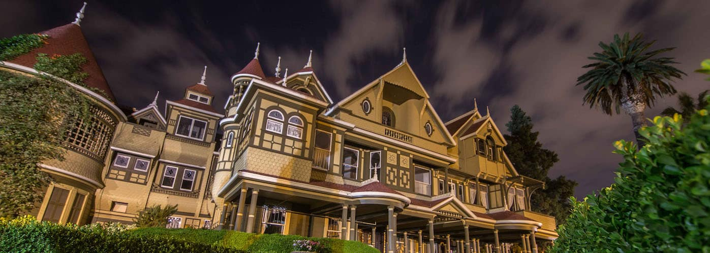 Winchester House pictured under a dark, stormy sky