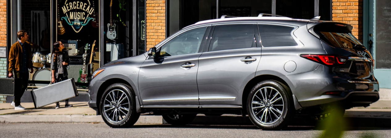 A 2020 INFINITI QX60 parked on a street