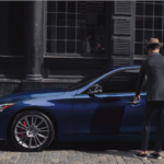 A man getting into a 2021 INFINITI Q50
