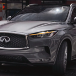 A 2021 INFINITI QX50 driving on a city street