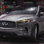 A 2021 INFINITI QX50 driving in a city