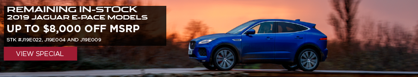 REMAINING IN-STOCK 2019 JAGUAR E-PACE MODELS UP TO $8,000 OFF MSRP STK #J19E022, J19E004 AND J19E009_VIEW SPECIAL_BLUE JAGUAR E-PACE DRIVING BY LAKE