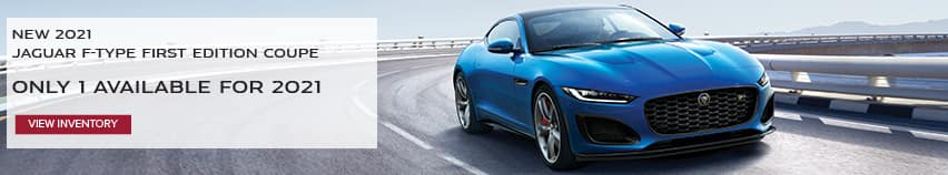 NEW 2021 JAGUAR F-TYPE FIRST EDITION COUPE. ONLY 1 AVAILABLE FOR 2021. VIEW INVENTORY. BLUE JAGUAR F-TYPE COUPE DRIVING DOWN ROAD IN CITY.