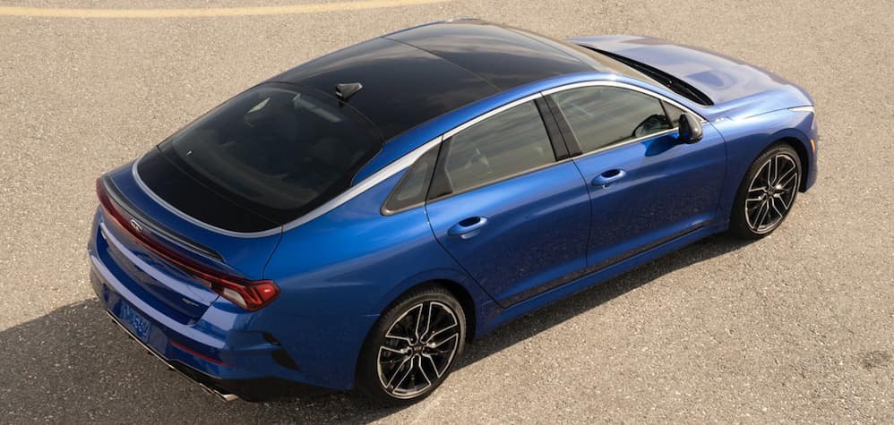 Blue 2021 Kia Optima parked