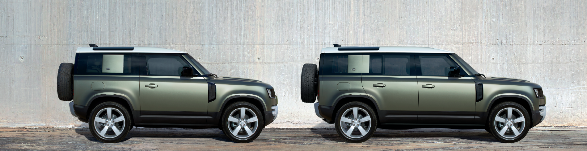 FEATURING THE 2020 LAND ROVER DEFENDER 90 AND 110 EDITION MODELS IN GREEN IN FRONT OF GRAY WALL