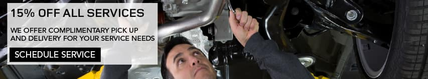 15 PERCENT OFF ALL SERVICES. WE OFFER COMPLIMENTARY PICK UP AND DELIVERY FOR YOUR SERVICE NEEDS. SCHEDULE SERVICE. IMAGE SHOW SERVICE TECH PERFORMING ROUTINE MAINTENCE UNDERNEATH THE BODY OF THE A VEHICLE.