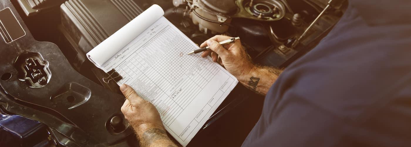 Mechanic Going Over Checklist