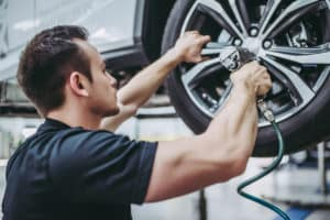 handsome auto service mechanic working on vehicle