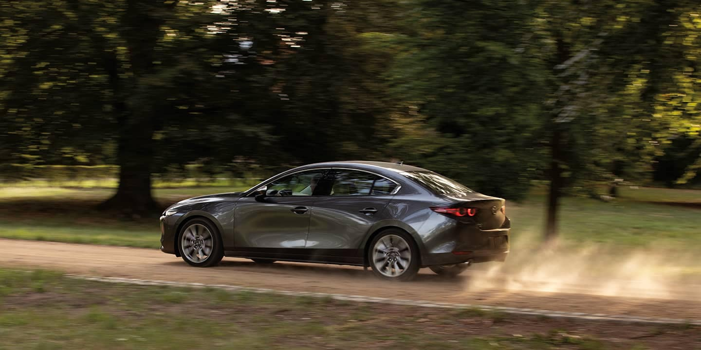 Mazda3 driving on dirt road