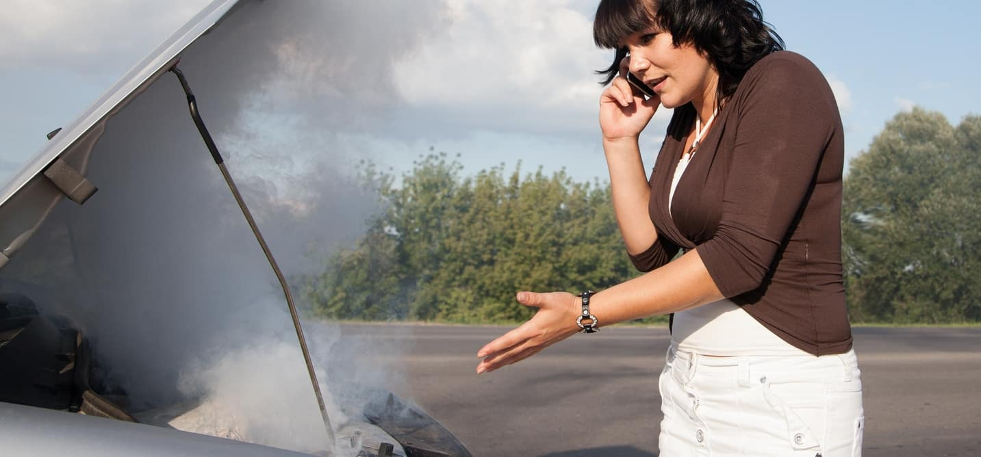 woman on the phone calling about overheated engine