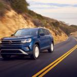 Blue 2021 Volkswagen Atlas driving down mountain road