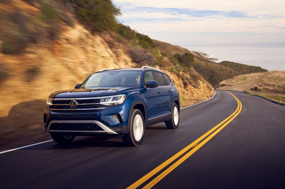 Blue 2021 Volkswagen Atlas driving down mountain road