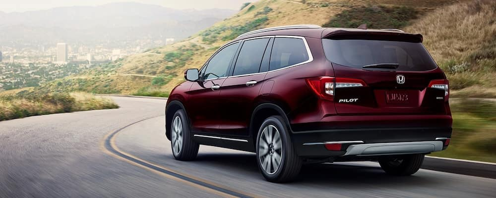 Red 2020 Honda Pilot on Highway