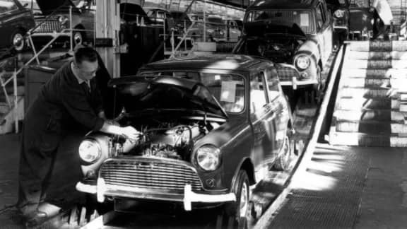 Alec Issigonis working on a Mini at the Mini factory