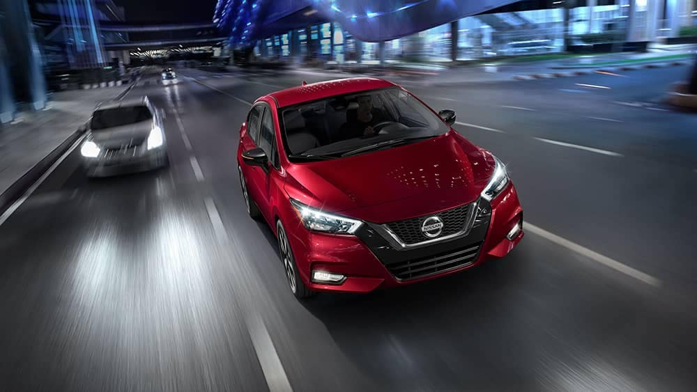 2020 Nissan Versa Driving a city street at night