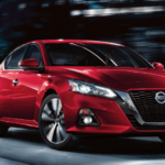 2020 Nissan Altima in red driving on LA city street