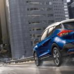 Blue 2020 Nissan Kicks driving in city