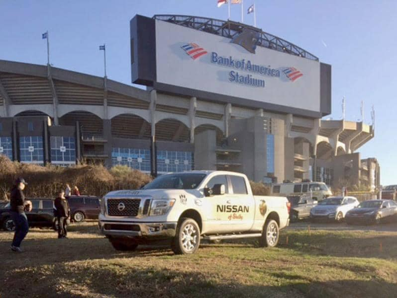 white nissan truck in front of bank of america stadium