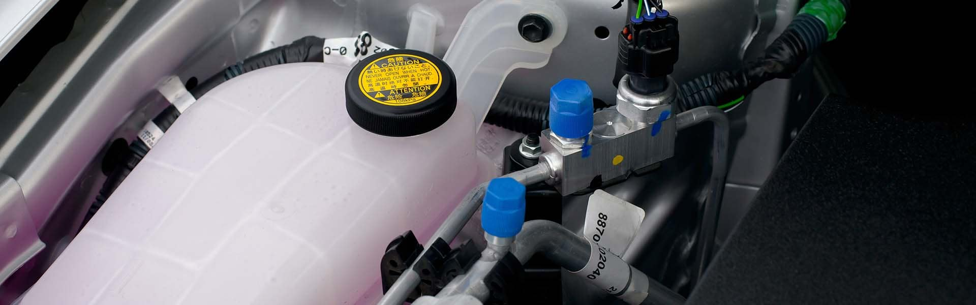 Coolant container in a car engine