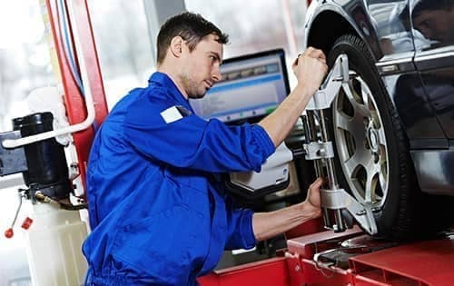 Mechanic doing a Tire Alignment
