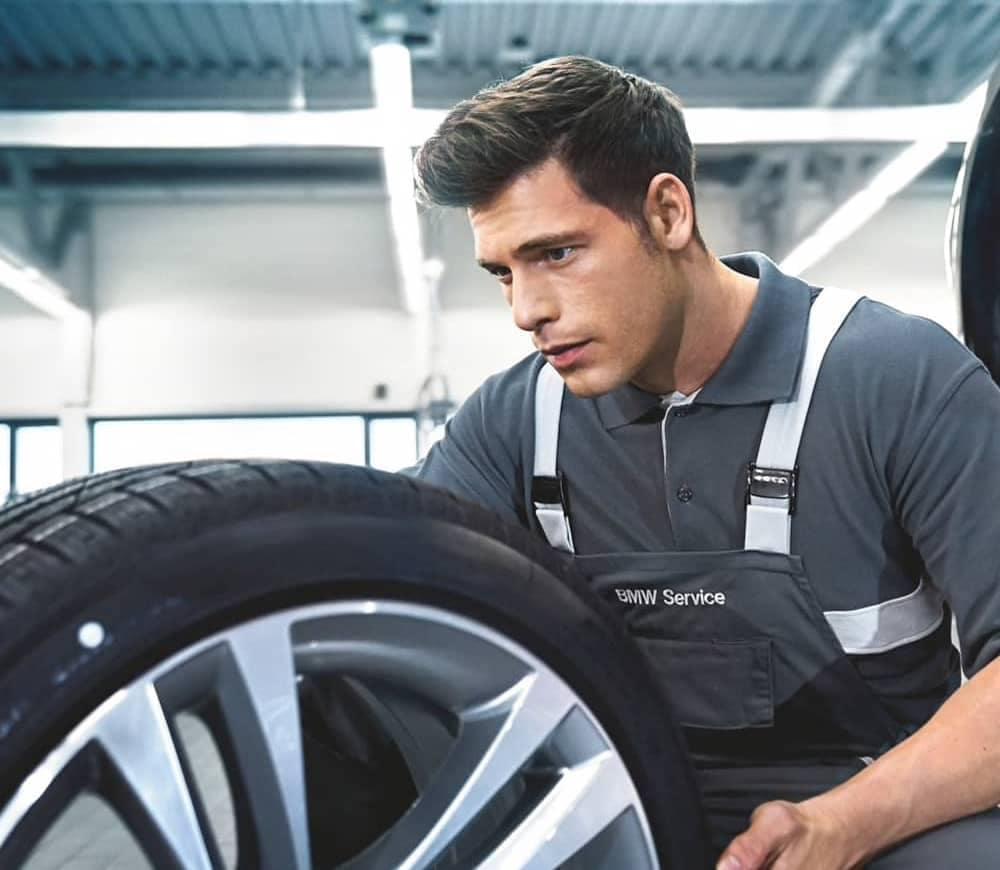 BMW Technician working on tire