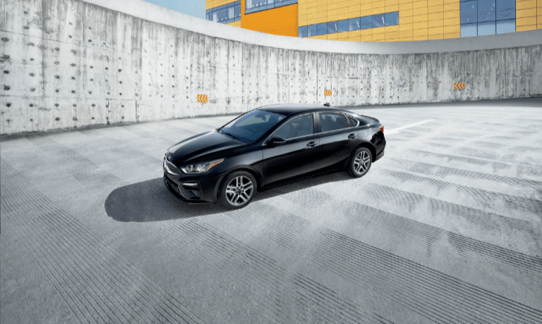 2020 Kia Forte parked in black driving up a ramp with concret walls