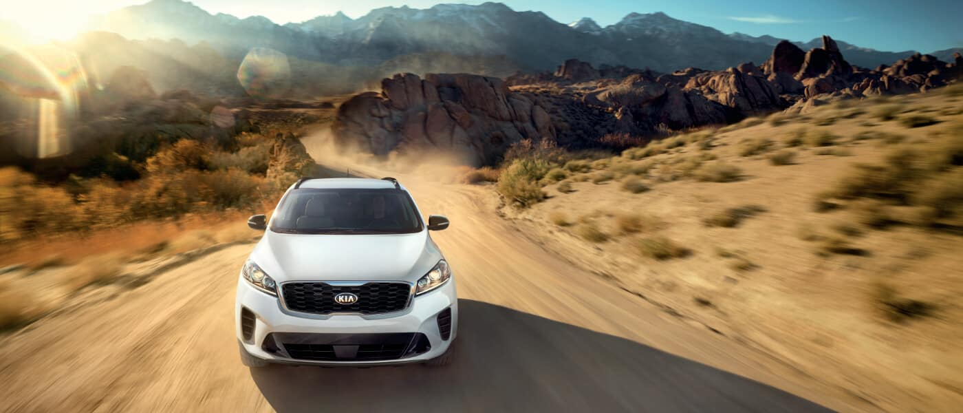 2020 Kia Sorento Exterior in white Driving on Desert road head on