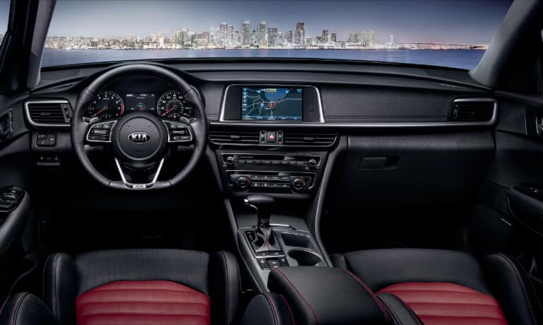 2020 Kia Optima interior front seats in black and red front dash