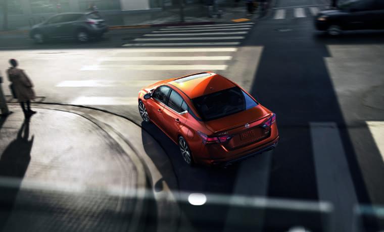 2020 nissan Altima in orange birds eye view of car turning onto city street