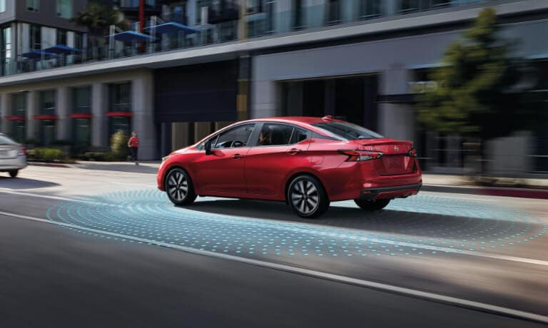 2020 Nissan Versa Exterior Driving In Town With Collision Sensors