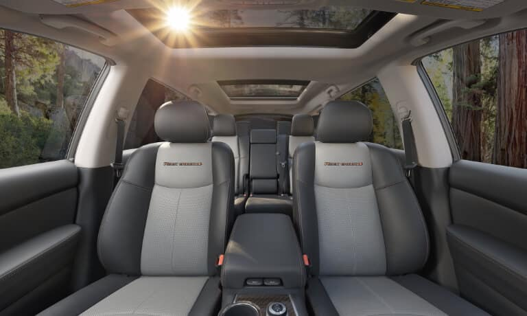 2020 Nissan Pathfinder interior in gray and black showing front to back seats from the front
