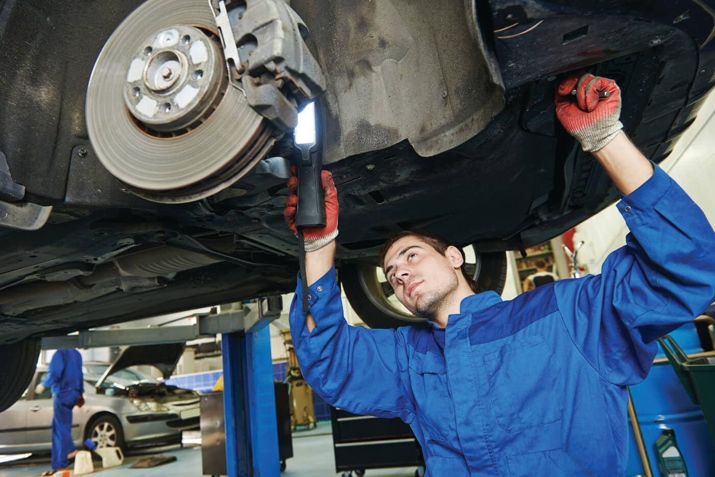 A mechanic inspecting brakes