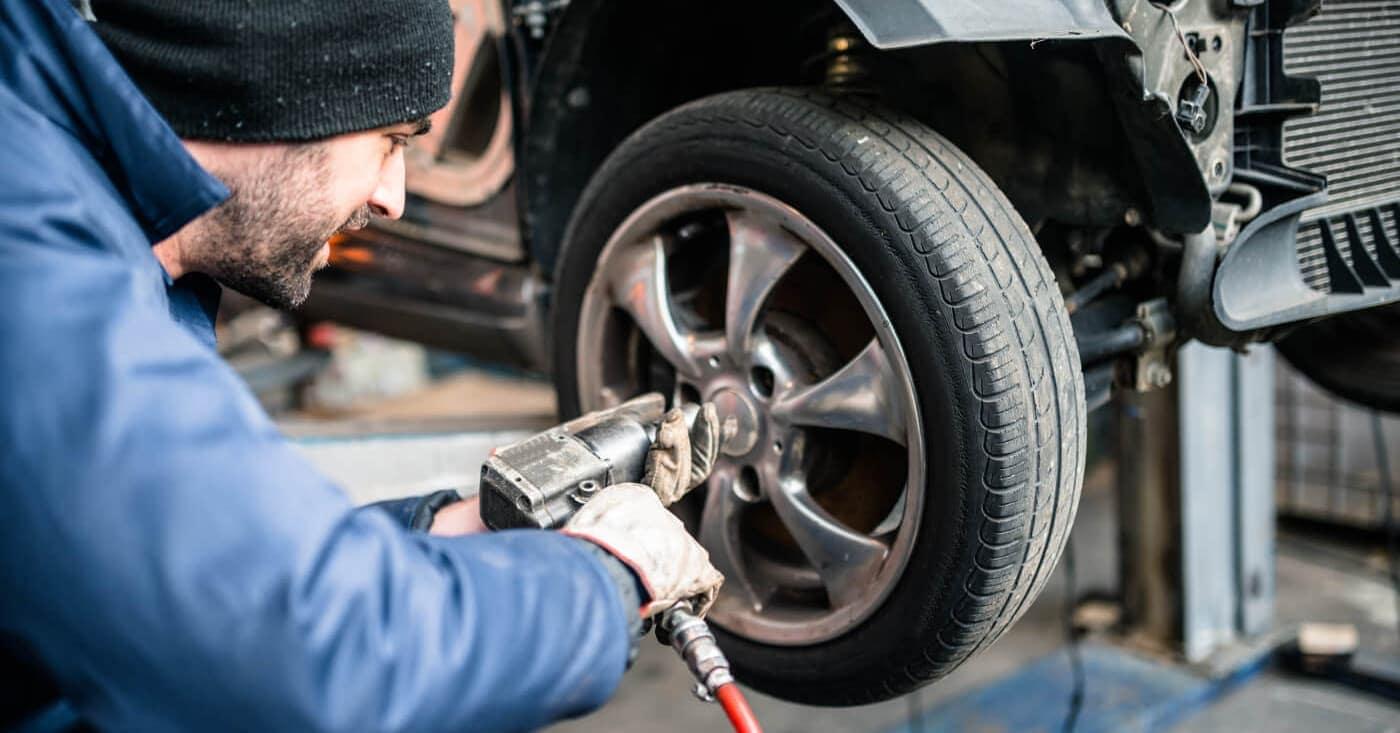 A mechanic fixing a tire